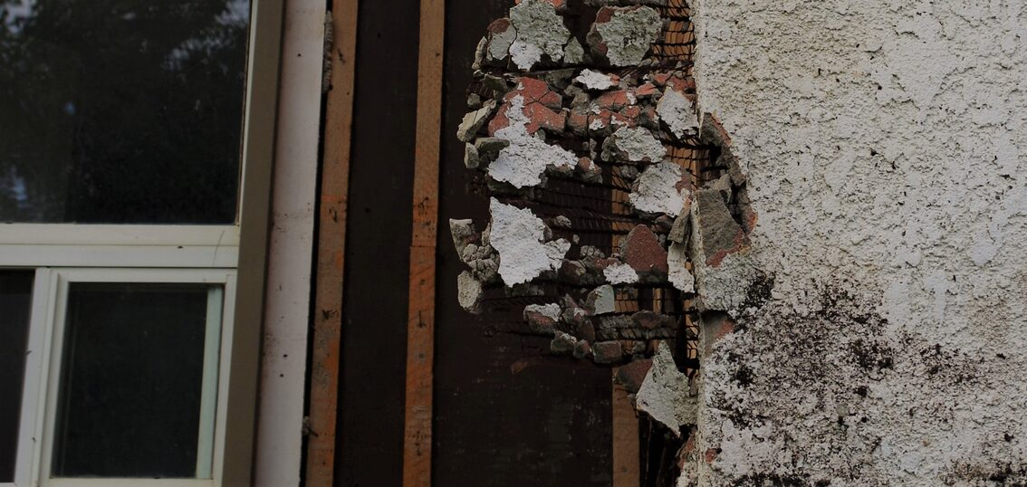 Asbestos on Decaying Outer Wall of Home